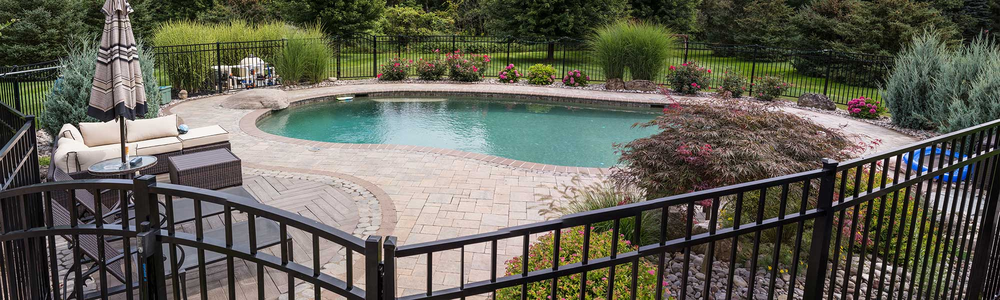 Gorgeous pool landscaping and hardscaping by Graf's lawn & Landscaping