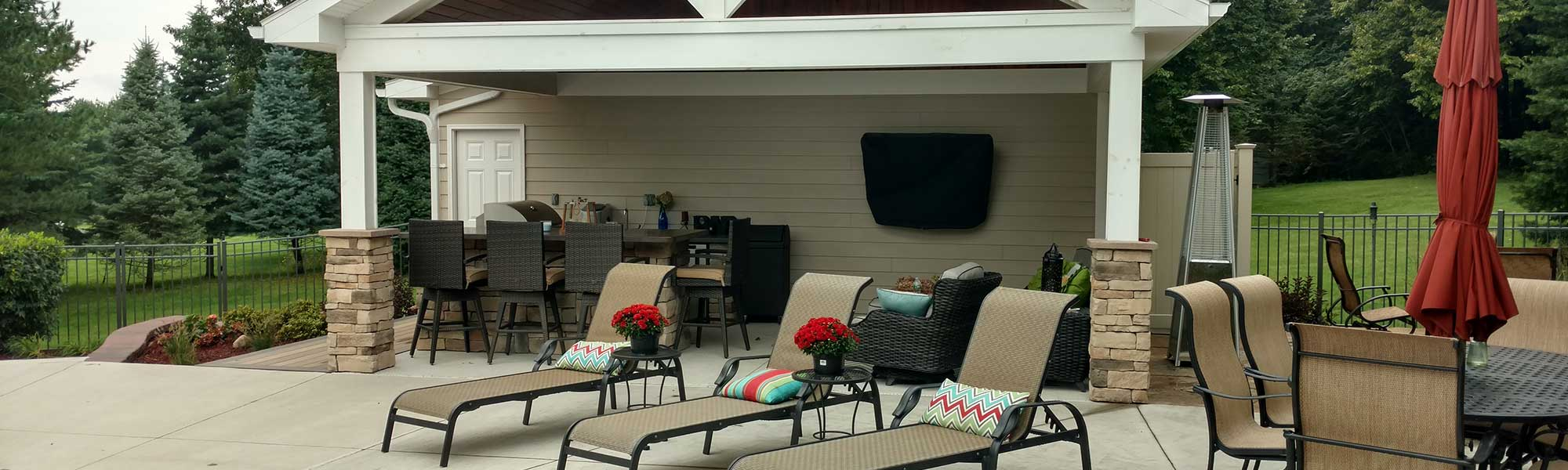 Outdoor living space hardscape and landscaping by Graf's Lawn & Landscaping LLC